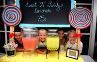 Girls learn about business world through lemonade stands