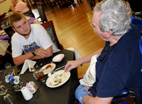 Seymour football players visit Shields House