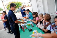 Local Girl Scout troop serves cookies, sundaes to first responders