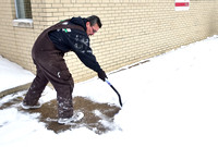 Weather keeps road crews busy, students home