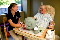 Volunteers offer companionship while hospital patients eat