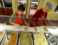 Holiday dinners blessing to volunteers, recipients alike