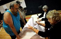Poll workers happy to help, find ways to pass time