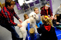 Library program features therapy dog while children read