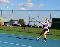 Trinity falls in girls tennis