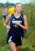 Trinity senior swaps pom-poms, running shoes